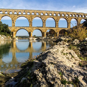 a roman aqueduct supplying water to a nearby city